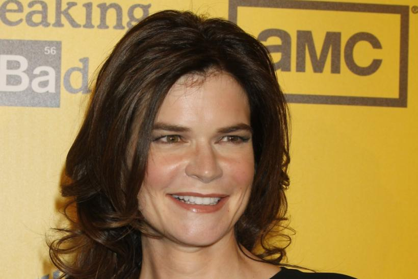 Actress Betsy Brandt, star of AMC's drama television series 'Breaking Bad' poses as she arrives for the premiere screening for the show's fourth season in Hollywood