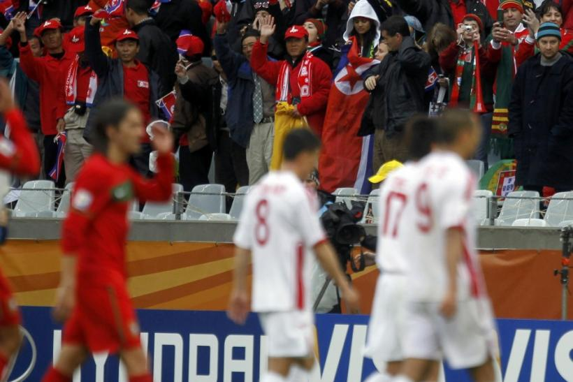 North Korea's fans cheer to their players after the 2010 World Cup group G soccer match against Portugal at Green Point stadium in Cape Town June 21, 2010.