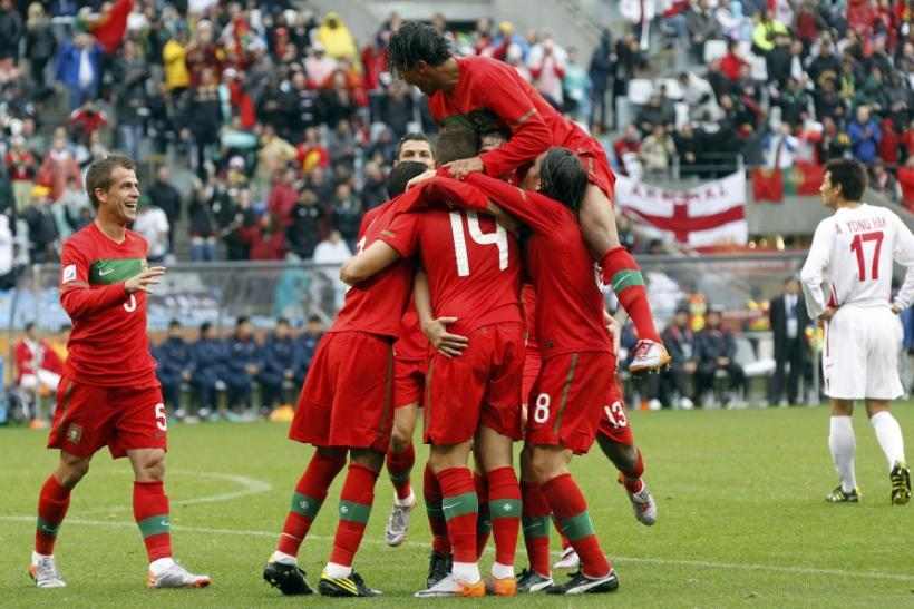 Portugal players celebrate a goal against North Korea during the 2010 World Cup group G soccer match at Green Point stadium in Cape Town June 21, 2010.