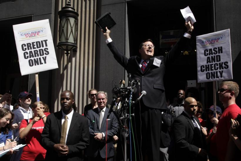 Stephen Colbert greets a crowd outside the Federal Election Commission