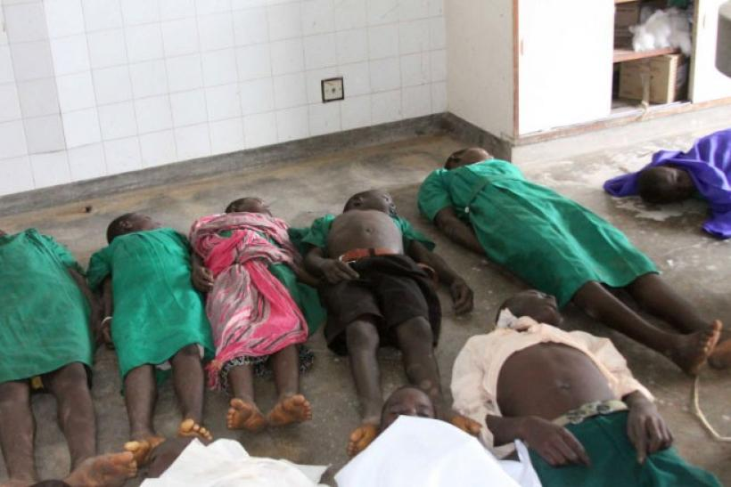 Bodies of children lie on the floor at a local morgue after they were killed when lightning hit a classroom at a school in Kiryandongo, 210 km (130 miles) north of Uganda's capital Kampala, June 29, 2011