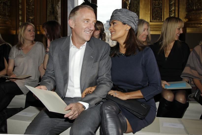 Actress Salma Hayek and her husband entrepreneur Francois-Henri Pinault attend the Spring/Summer 2011 ready-to-wear women's fashion collection designed by British designer Stella McCartney during Paris Fashion Week