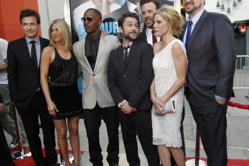 """Gordon poses with cast members Bateman, Aniston, Foxx, Day, Sudeikis and Bowen at the premiere of """"Horrible Bosses"""" at the Grauman's Chinese theatre in Hollywood"""