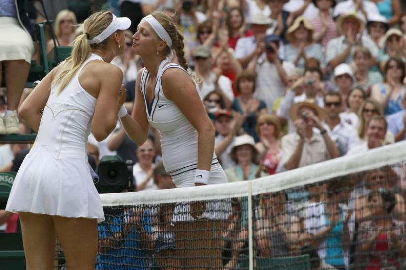 Petra Kvitova of the Czech Republic (R) kisses Maria Sharapova of Russia after defeating her in their final match