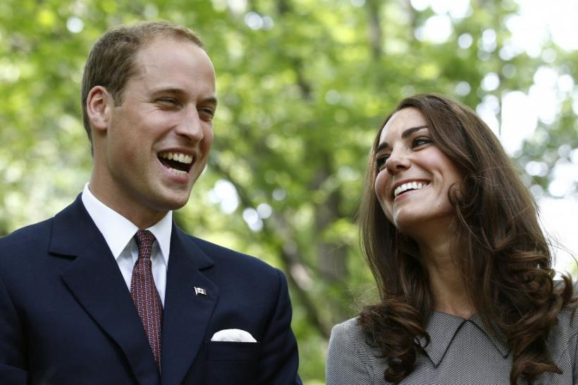 Britain's Prince William and his wife Catherine, Duchess of Cambridge, laugh during a tree planting ceremony at Rideau Hall in Ottawa