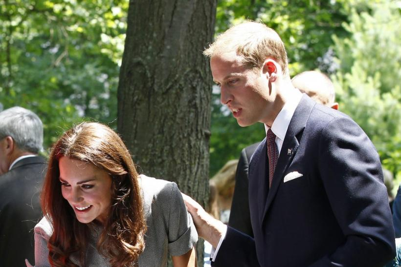 Britain's Prince William introduces his wife Catherine, Duchess of Cambridge, during a tree planting ceremony at Rideau Hall in Ottawa