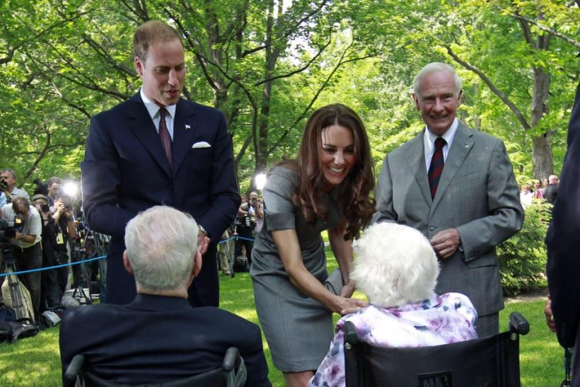 Britain's Prince William and his wife Catherine, Duchess of Cambridge, greet a couple during a tree planting ceremony at Rideau Hall in Ottawa