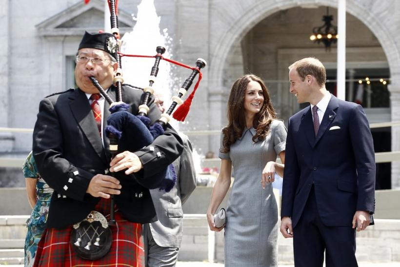 Britain's Prince William and his wife Catherine, Duchess of Cambridge, walk to a tree planting ceremony at Rideau Hall in Ottawa
