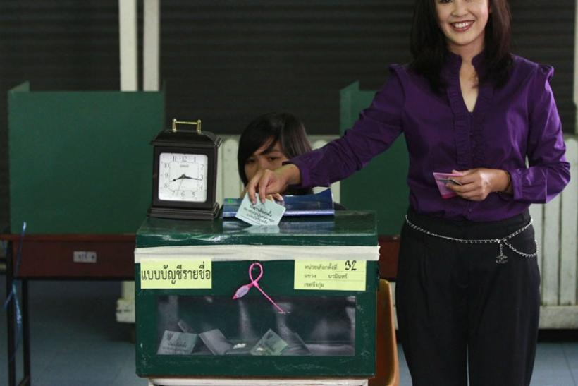 Puea Thai Party's PM candidate Yingluck Shinawatra casting her vote
