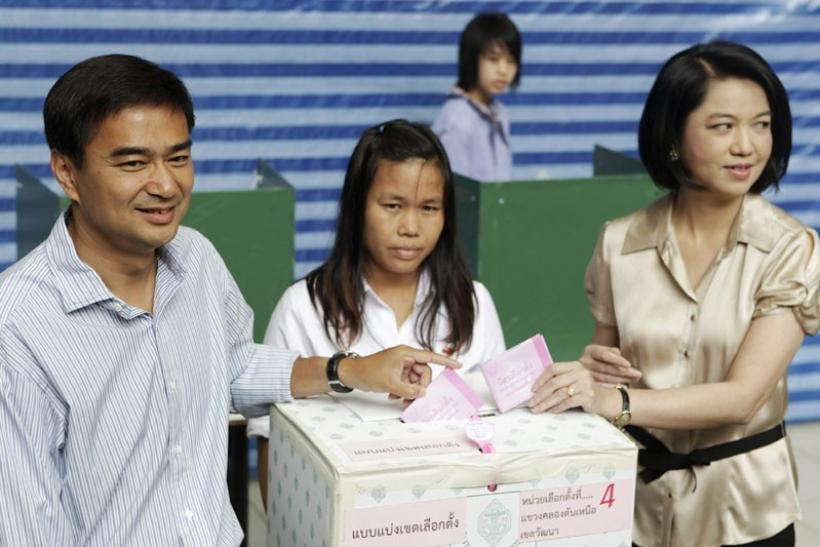 Thai Prime Minister Abhisit Vejjajiva and his wife Pimpen casting their votes
