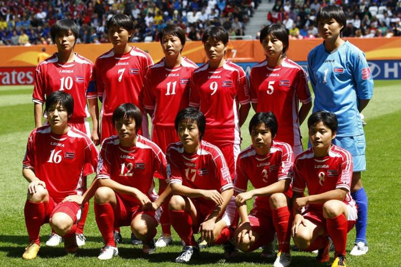 North Korea players pose before their match between Sweden and North Korea