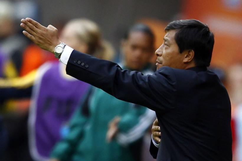 North Korea's coach Kim Kwang Min gestures in the match