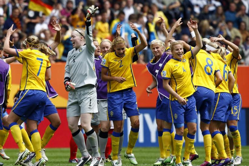 Sweden players celebrate after defeating North Korea