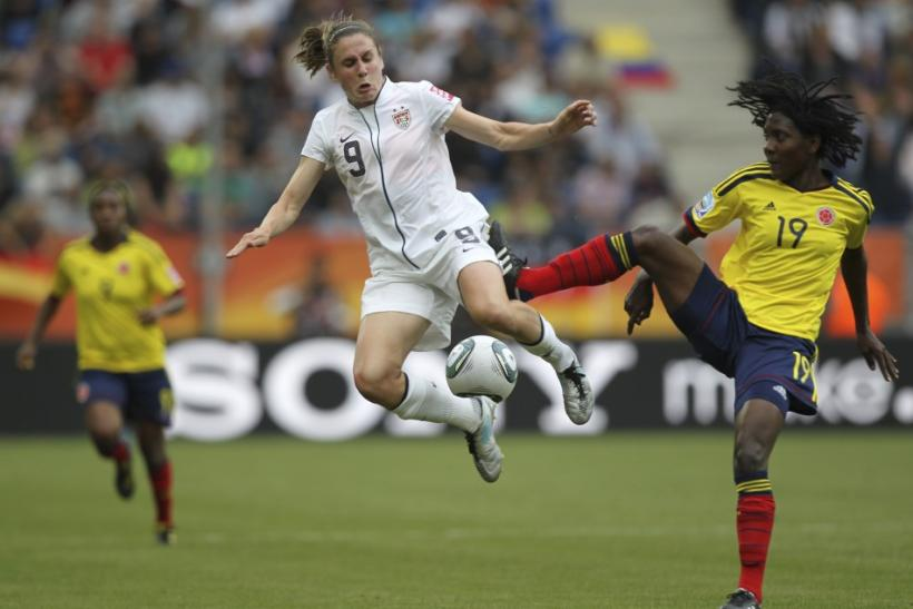 Fatima Montano of Colombia (R) challenges Heather O'Reilly of the U.S.