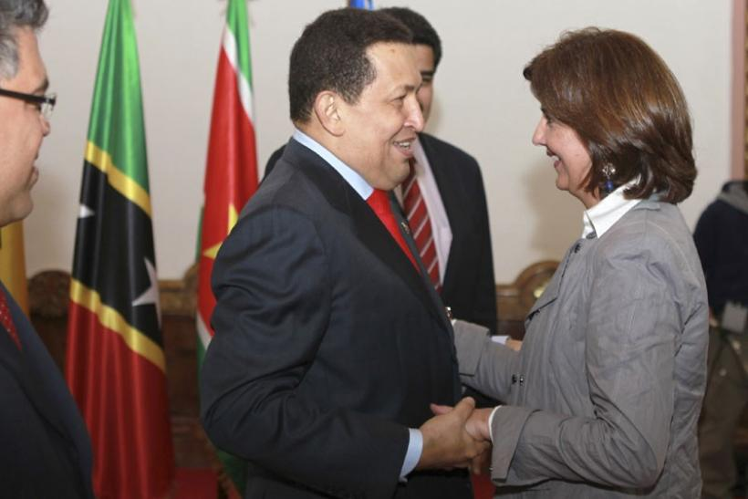 Venezuela's President Hugo Chavez greets Colombia's Foreign Minister Maria Angela Holguin (R) at Miraflores palace in Caracas