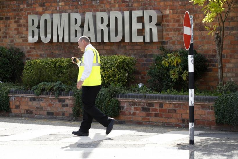 A worker walks past the entrance to the Bombardier plant in Derby