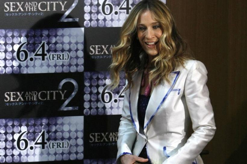 "Actress Sarah Jessica Parker steps on stage to pose for photographers during a photo call for ""Sex and the City 2"""