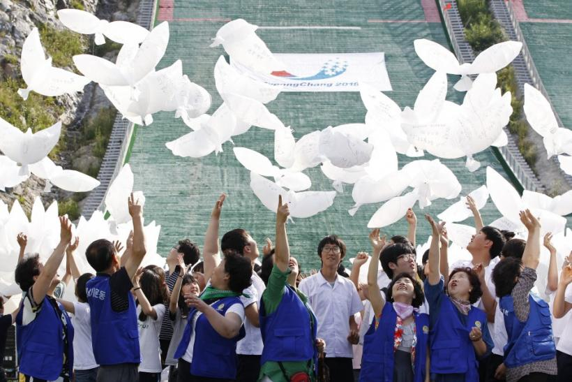 South Koreans release dove-shaped balloons as they cheer for South Korea's bid to host the 2018 Winter Olympic Games in Pyeongchang