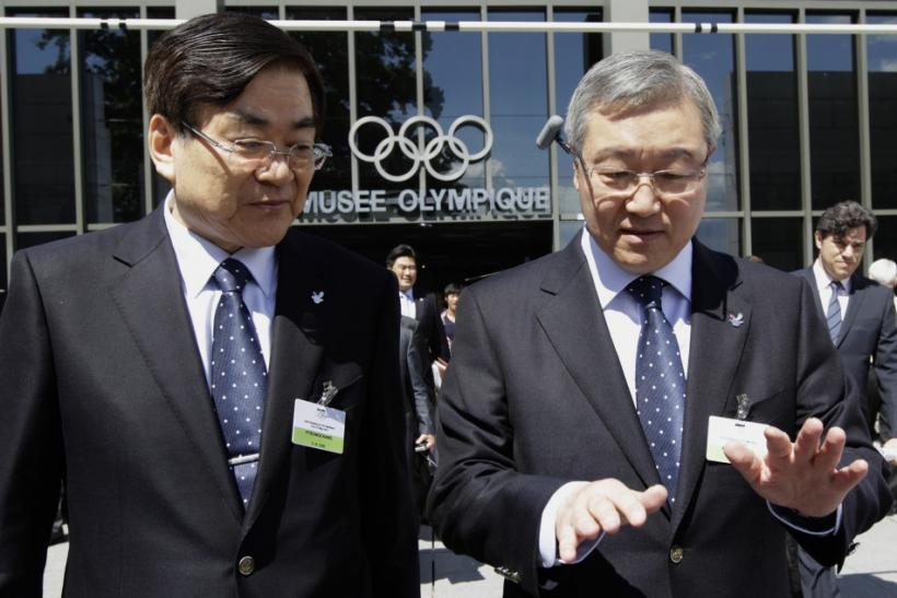 Cho PyeongChang 2018 Winter Olympic bid Chairman walks out with Kim South Korea's Foreign Affairs and Trade Minister after their presentation to the IOC members in Lausanne