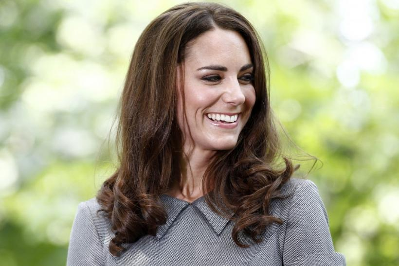 Catherine, Duchess of Cambridge, laughs during a tree planting ceremony
