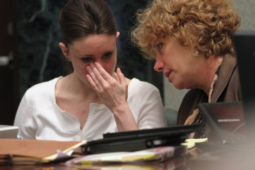 Casey Anthony (L) talks with her attorney Dorothy Clay Sims during her murder trial at the Orange County Courthouse in Orlando, Florida, May 24, 2011.