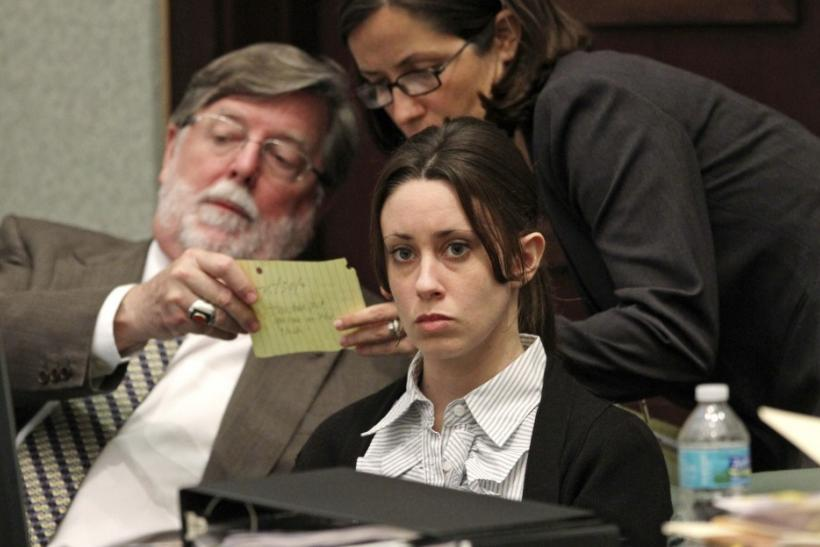 Casey Anthony sits at the defense table with her attorneys Cheney Mason and Lisabeth Fryer during the second day of testimony in her first-degree murder trial at the Orange County Courthouse in Orlando, Florida May 25, 2011.