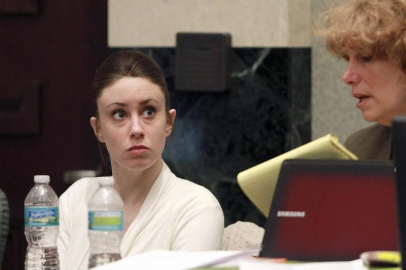 Casey Anthony (L) sits with her attorney Dorothy Clay Sims before the start of her murder trial at the Orange County Courthouse in Orlando, Florida, June 9, 2011.
