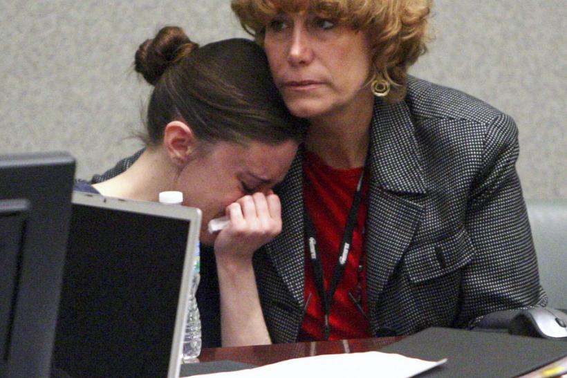 Casey Anthony (L) sobs in the arms of defense attorney Dorothy Clay Sims after graphic photos showing the bones of Caylee Anthony are displayed during day 15 of her first-degree murder trial at the Orange County Courthouse, in Orlando, Florida, June 10, 2