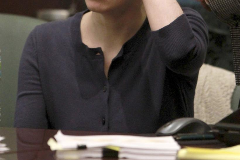 Casey Anthony tries to collect herself during a break in her murder trial at the Orange County Courthouse in Orlando, Florida, June 10, 2011.
