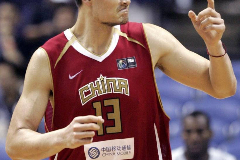 China's Yao reacts during the first round game against the US at the world basketball championships in Sapporo