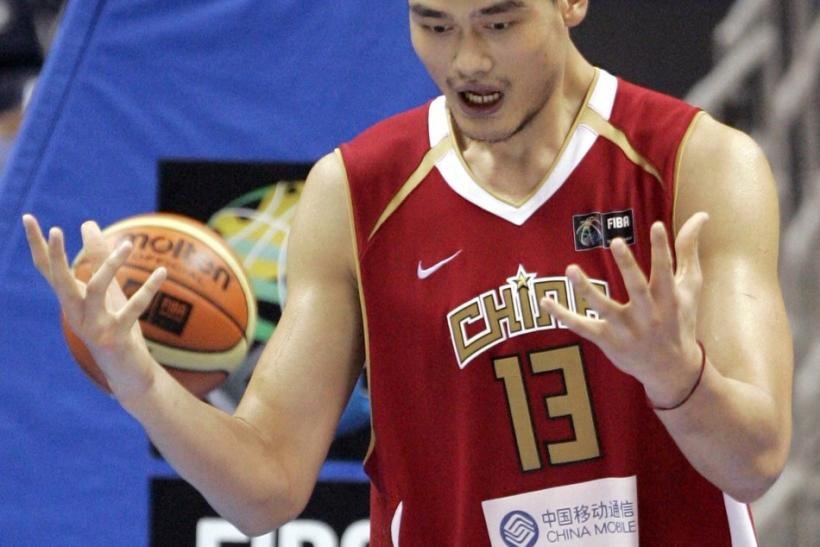 China's Yao celebrates their win against Senegal during the first round of the world basketball championships in Sapporo