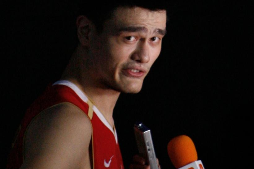 China's Yao talks with reporters after loss against Greece during their world basketball championships game in Saitama