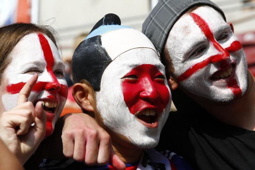 Supporters cheer before the match between England and Japan