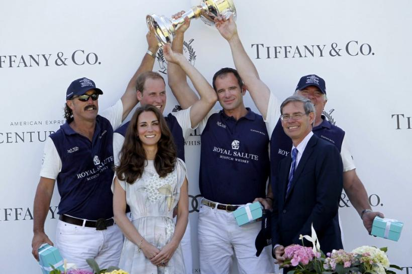 Catherine, Duchess of Cambridge, poses after presenting awards to her husband's team following a polo match at the Santa Barbara Polo and Racquet Club