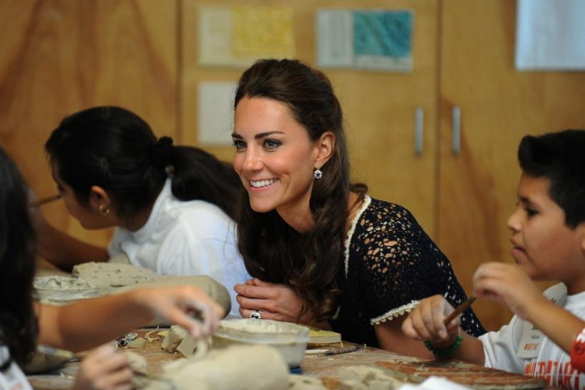 Catherine, the Duchess of Cambridge, works on a clay turtle project with students during a visit to the Inner-City Arts campus in Los Angeles