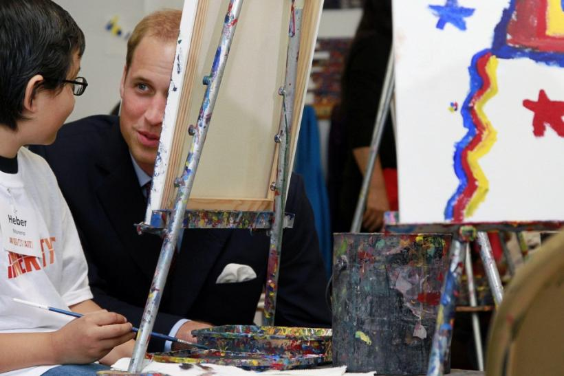 Heber Moreno talks with Britain's Prince William during a tour of the Inner City Arts campus in Los Angeles California
