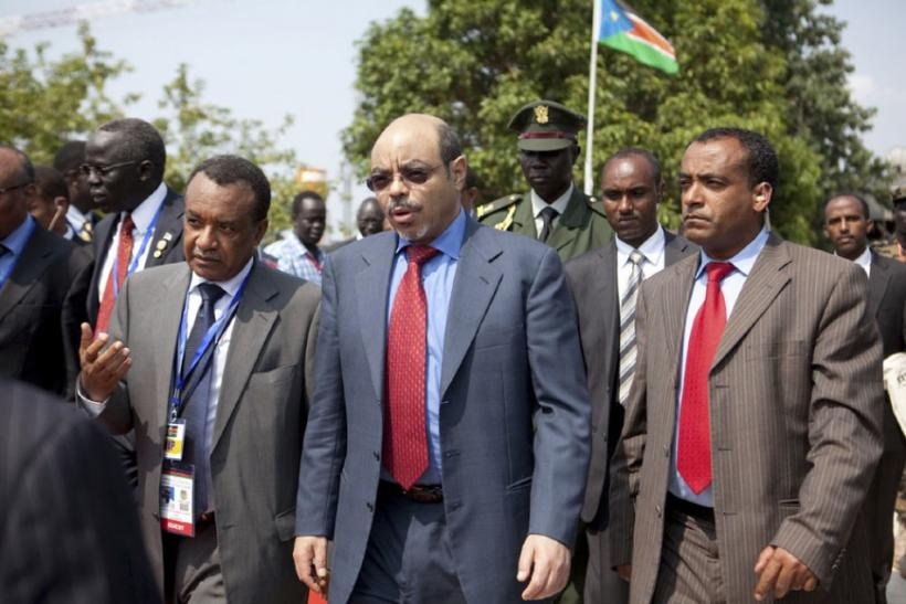 Ethiopia's Prime Minister Meles Zenawi (C) arrives at Juba airport