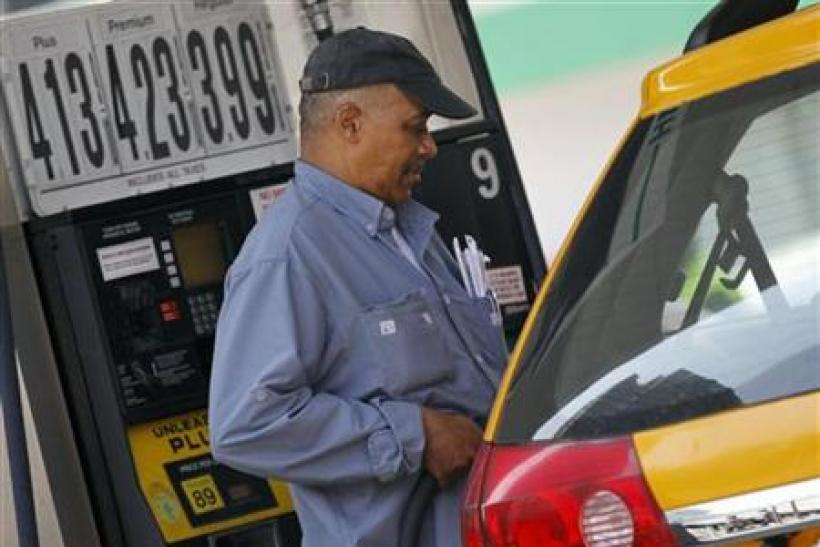 A taxicab driver fills his tank at a gas station in Midtown Manhattan