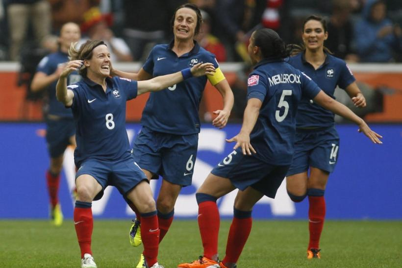 France's Bompastor celebrates with teammates her goal against the U.S. during their Women's World Cup semi-final soccer match in Monchengladbach