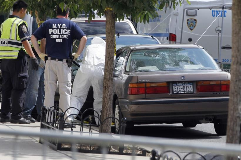 NYPD crime scene investigators inspect the car of the suspected killer of Kletzky outside his home in the Orthodox Jewish section of Borough Park