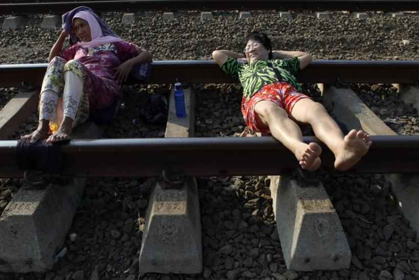 Railway Therapy in Indonesia Lie on the tracks