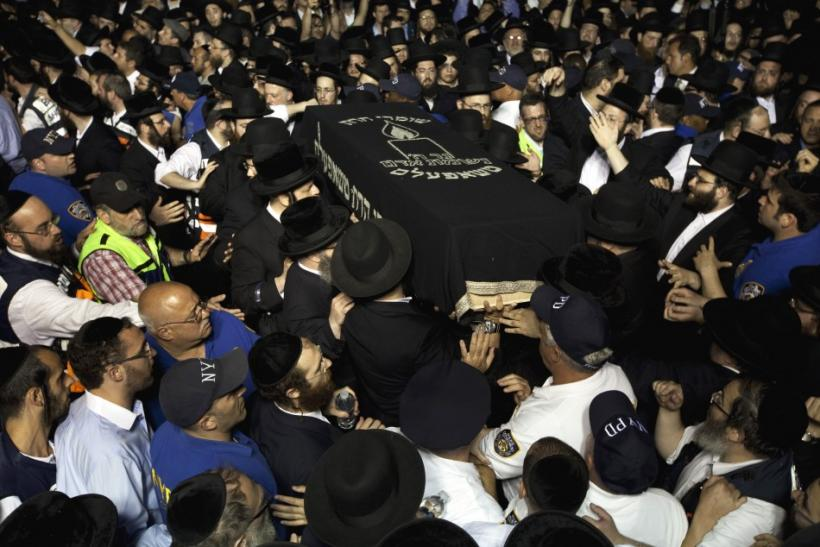 The casket of Leiby Kletzky is carried into a synagogue for his funeral service in New York