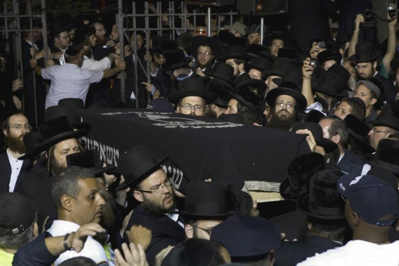 The casket of Leiby Kletzky is carried out of a synagogue after his funeral service in New York