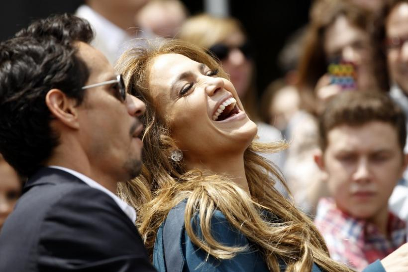 Lopez laughs next to her husband Anthony as they attend the ceremony where producer Fuller was honored with a star on the Walk of Fame in Hollywood