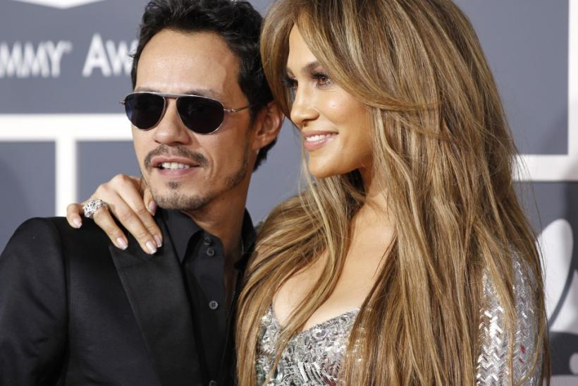 Jennifer Lopez and Marc Anthony pose on arrival at the 53rd annual Grammy Awards in Los Angeles