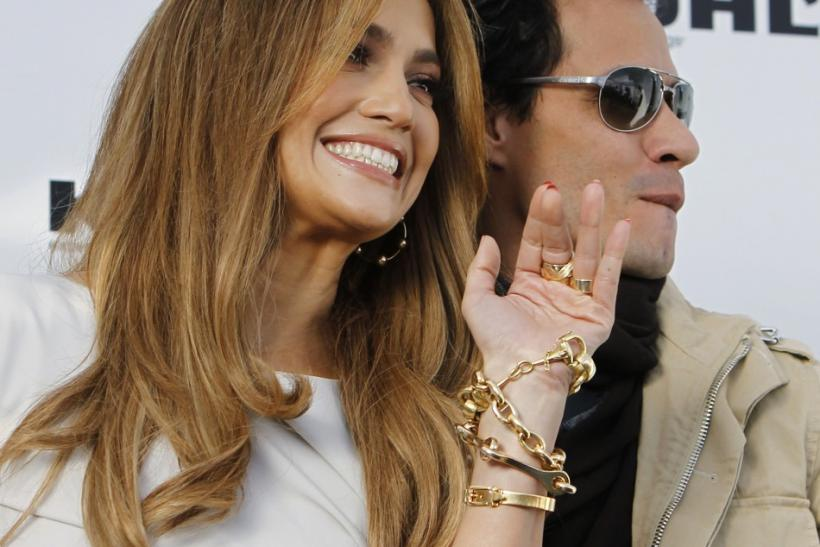 "Lopez and her husband pose at a news conference to announce ""The Jennifer Lopez and Marc Anthony ""collections in partnership with Kohl's Department Stores in California"