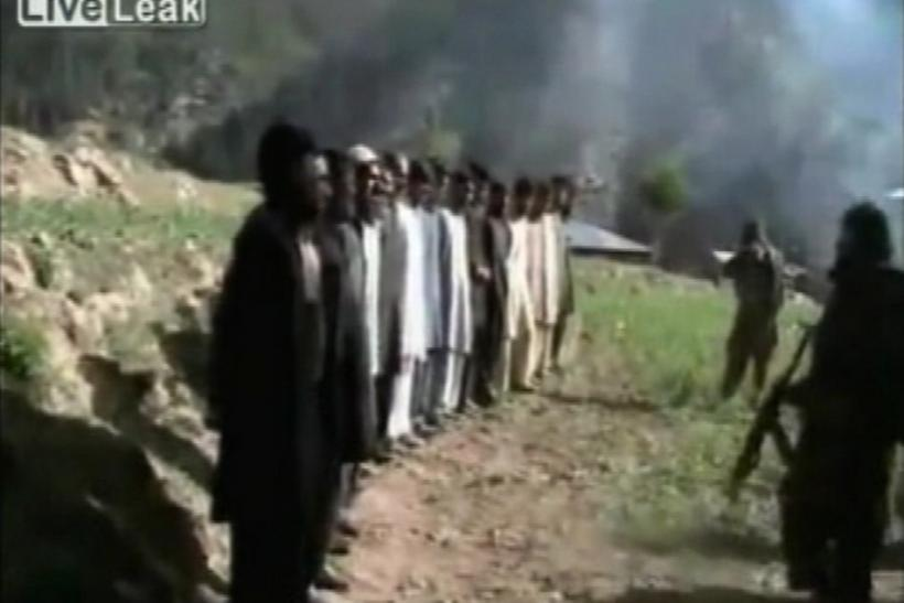Video grab of Taliban lining up Pakistani security personnel before shooting at them in a firing squad style