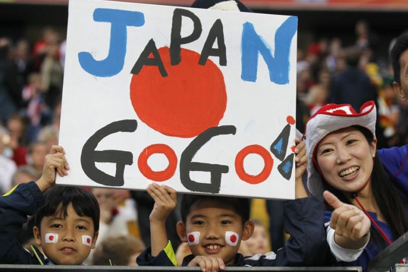 Fans of Japan cheer before the start of the Women's World Cup final soccer match between Japan and the U.S. in Frankfurt
