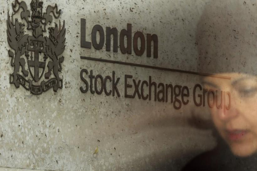 A City worker passes the Stock Exchange in London