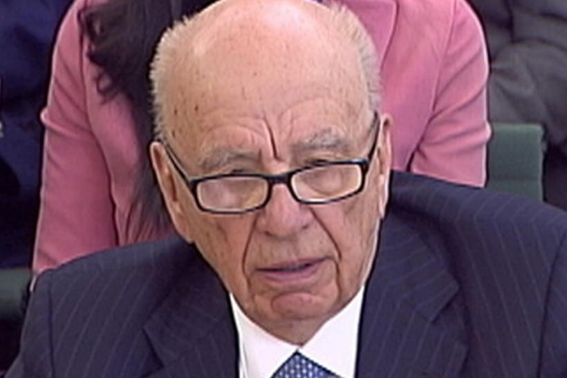 News Corp Chief Executive and Chairman Rupert Murdoch appears before a parliamentary committee on phone hacking at Portcullis House in London